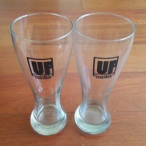 NWOT UP Comedy Set of 2 souvenir 16 oz glasses